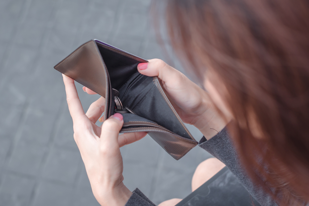 an individual holding an empty wallet