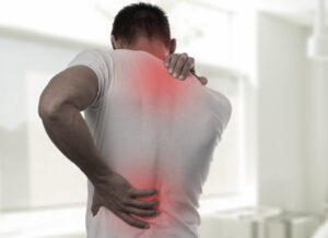 back and neck of man suffering pain
