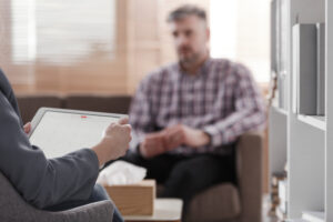 man talking with a therapist