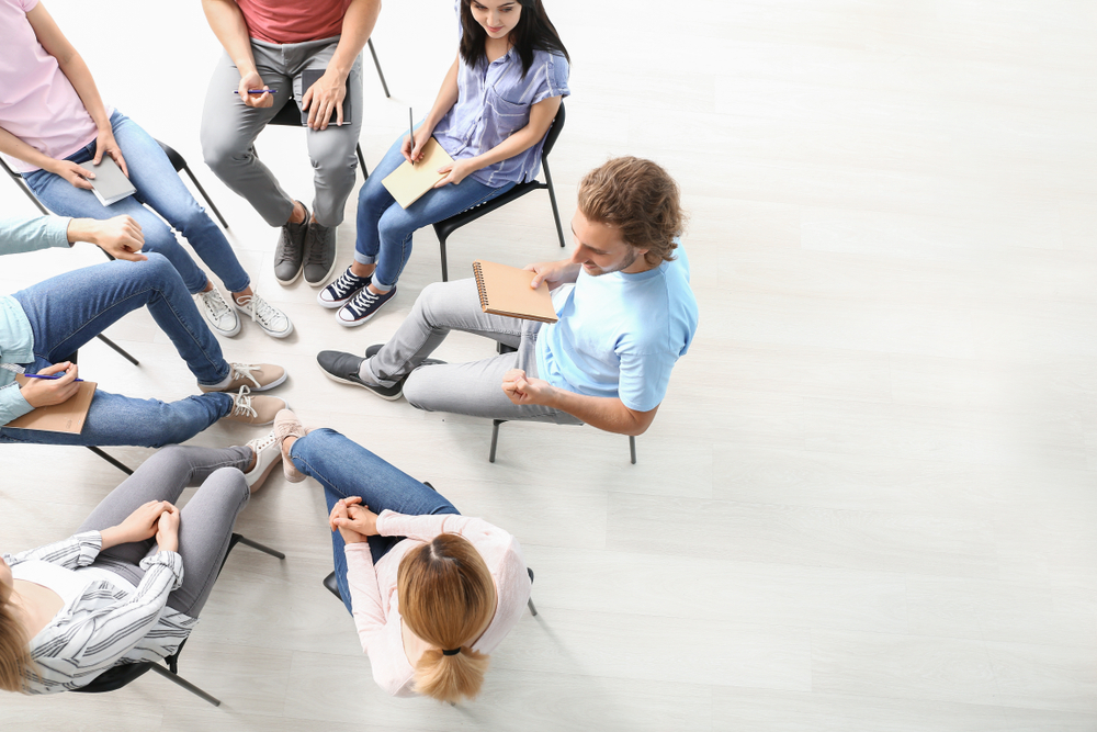 people in group counseling session