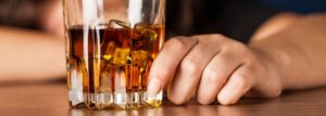 woman hand on alcohol glass