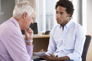 middle-aged man receiving cognitive behavioral therapy for addiction