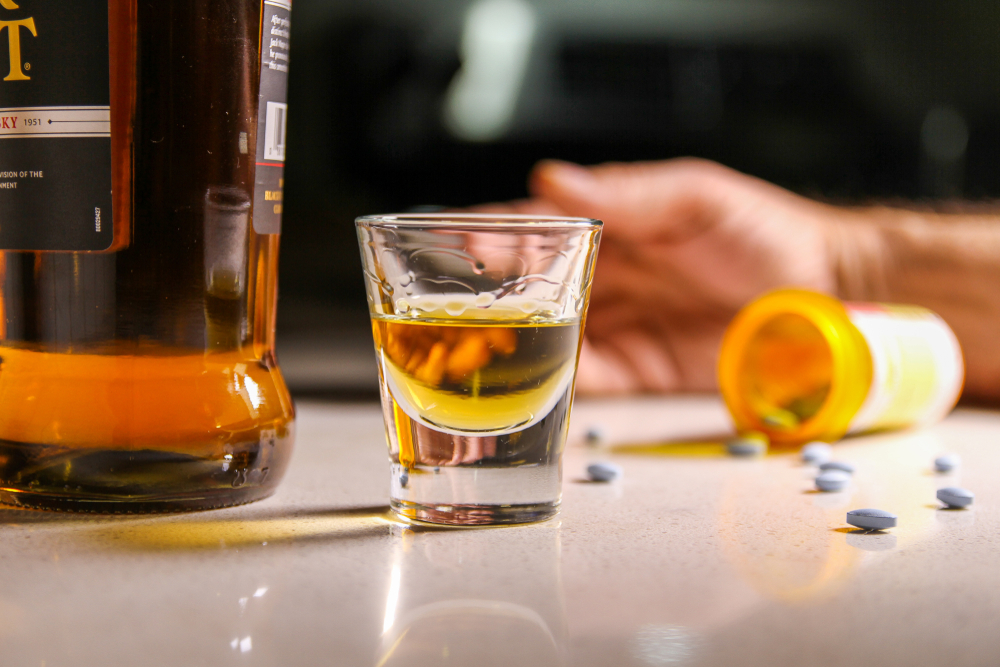 person overdosing on opioids and alcohol