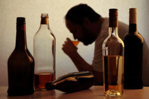 silhouette of man abusing alcohol