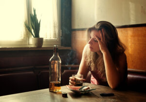 unhappy woman drinking alcohol