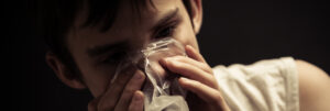 young person sniffing inhalants