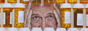 unhappy senior man surrounded by pills